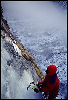 Topping out the stalactite of the Moulins Falls, La Grave. Alps, France