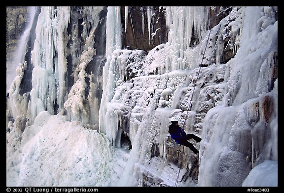 Rappeling from an ice climb in Provo Canyon, Utah. USA (color)