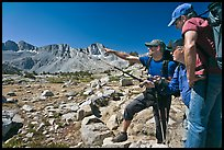 Hikers pointing, Dusy Basin. Kings Canyon National Park, California