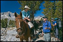 Horseman speaking with hikers, Dusy Basin. Kings Canyon National Park, California