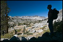 Hiker silhouetted, lower Dusy Basin. Kings Canyon National Park, California