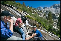 Crew filming a waterfall, lower Dusy Basin. Kings Canyon National Park, California