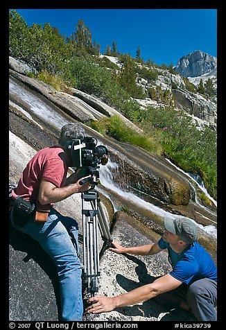 Men filming a waterfall, lower Dusy Basin. Kings Canyon National Park, California (color)