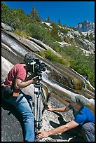 Men filming a waterfall, lower Dusy Basin. Kings Canyon National Park, California