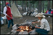 Women preparing food at camp, Le Conte Canyon. Kings Canyon National Park, California