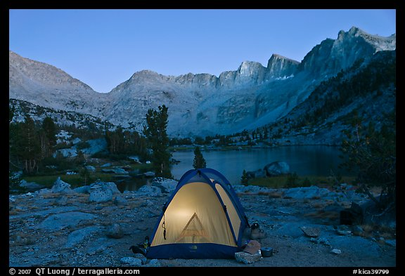 Tent with light and Palisades at dusk, lower Dusy Basin. Kings Canyon National Park, California (color)