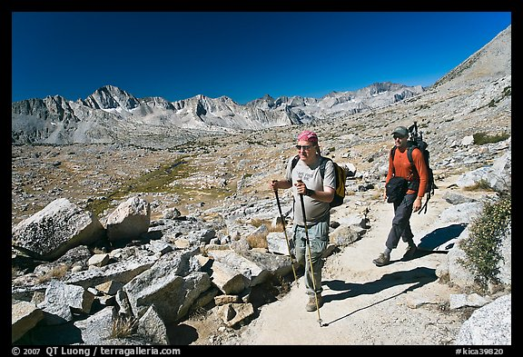 Hikers on trail below Biship Pass, Dusy Basin. Kings Canyon National Park, California (color)