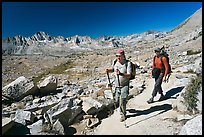Hikers on trail below Biship Pass, Dusy Basin. Kings Canyon National Park, California