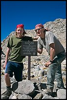 Father and son standing next to Bishop Pass sign. Kings Canyon National Park, California