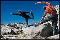 Hikers doing stretching exercises, Bishop Pass. Kings Canyon National Park, California (color)