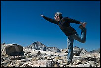 Hiker stretching, Bishop Pass. Kings Canyon National Park, California (color)