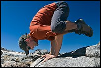 Hiker balancing on hands on rock, Bishop Pass. Kings Canyon National Park, California (color)