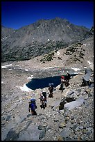 Backpackers near a tarn Lake. Kings Canyon National Park, California