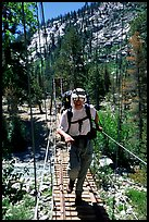 Crossing a river on a suspension bridge. Kings Canyon National Park, California