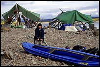 Inflating the canoe next to an Eskimo fish camp in Ambler. Kobuk Valley National Park, Alaska