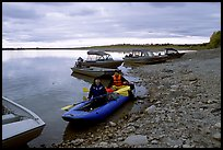 Putting up the canoe in Ambler. Kobuk Valley National Park, Alaska (color)
