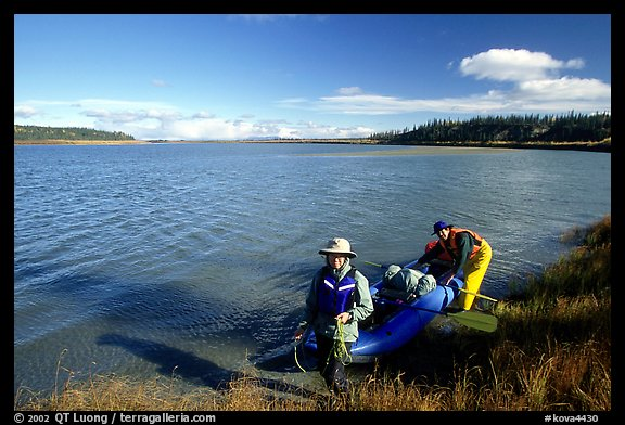 Canoeist with inflatable canoe on the shores of Kobuk River. Kobuk Valley National Park, Alaska (color)