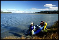 Canoeist with inflatable canoe on the shores of Kobuk River. Kobuk Valley National Park, Alaska