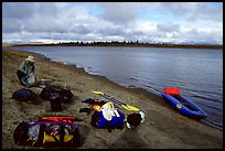 Canoeist packing the camping gear. Kobuk Valley National Park, Alaska
