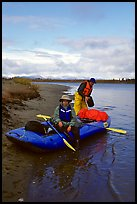 Canoeists finish  loading  with the boat prior to launching. Kobuk Valley National Park, Alaska