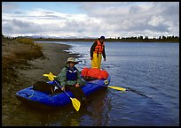 Canoeists ready to lauch with the boat loaded up. Kobuk Valley National Park, Alaska