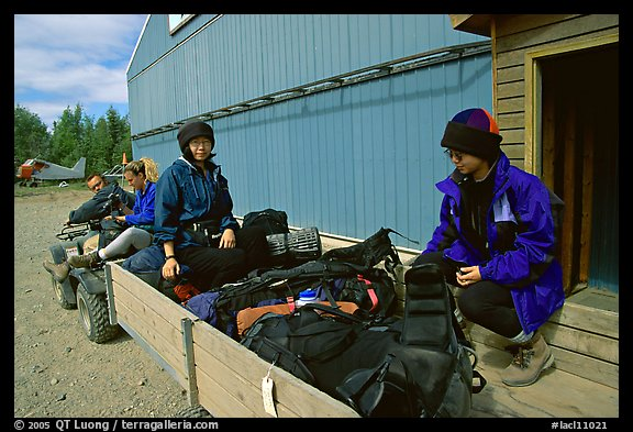 Riding on the trailer with the gear. Lake Clark National Park, Alaska (color)