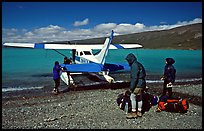 Backpackers dropped off by floatplane on Lake Turquoise. Lake Clark National Park, Alaska