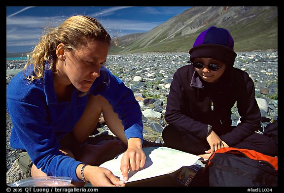 Women hikers consulting a map. Lake Clark National Park, Alaska (color)
