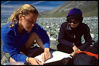 Women hikers consulting a map. Lake Clark National Park, Alaska