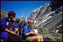 Women hikers pausing below the Telaquana Mountains. Lake Clark National Park, Alaska (color)