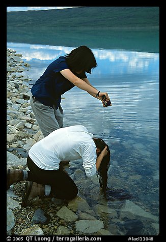 Backpackers cleaning up in Turquoise Lake. Lake Clark National Park, Alaska (color)