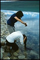 Backpackers cleaning up in Turquoise Lake. Lake Clark National Park, Alaska