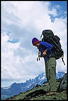 Woman backpacker with a large backpack. Lake Clark National Park, Alaska