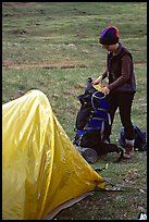 Backpacker unpacking backpack into the tent. Lake Clark National Park, Alaska