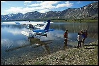 Backpackers being picked up by floatplane at Twin Lakes. Lake Clark National Park, Alaska (color)