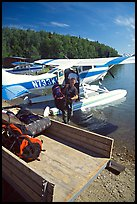 Backpackes being unloaded from floatplane in Port Alsworth. Lake Clark National Park, Alaska (color)