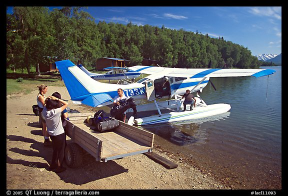 Backpackes being unloaded from floatplane to a trailer in Port Alsworth. Lake Clark National Park, Alaska (color)