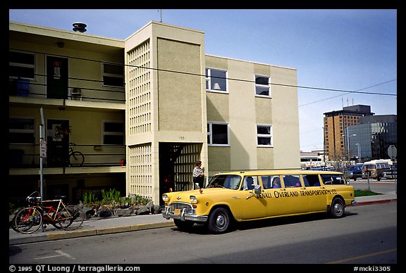 Denali overland shuttle in front of the Youth Hostel in Anchorage. Alaska (color)