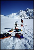 Hauling heavy loads on the Kahilna Glacier,  including mostly food and fuel for three weeks and polar-grade gear. Denali, Alaska (color)
