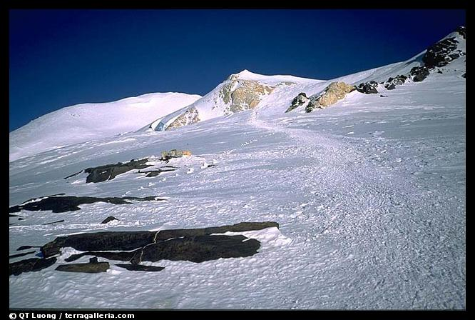 Junction with the West Buttress route (see the numerous crampon marks) on the summit plateau. Denali, Alaska (color)