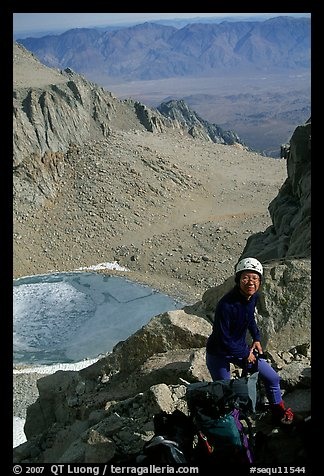 Woman gearing up to climb  East face of Mt Whitney. Sequoia National Park, California