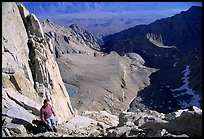 Man pausing on steep terrain in the East face of Mt Whitney. Sequoia National Park, California (color)