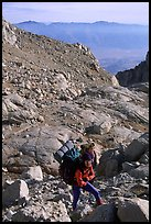 Mountaineers hiking on approach to  East face of Mt Whitney. Sequoia National Park, California (color)