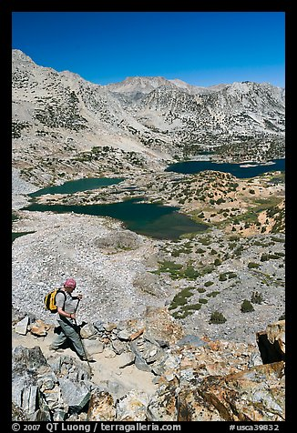 Hiker on trail above Saddlebag Lakes, John Muir Wilderness. Kings Canyon National Park, California (color)