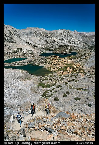 Hikers on trail above Saddlebag Lakes, John Muir Wilderness. Kings Canyon National Park, California