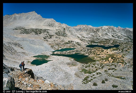 Hikers looking at view  above Saddlebag Lakes, John Muir Wilderness. Kings Canyon National Park, California (color)
