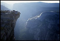 Hanging dramatically from the Jumping Board, Half-Dome. Yosemite National Park, California (color)
