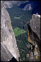 Climbers on Lost Arrow spire and Yosemite falls wall. Yosemite National Park, California (color)