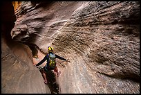 Hiker in slot canyon, Mystery Canyon. Zion National Park, Utah ( color)