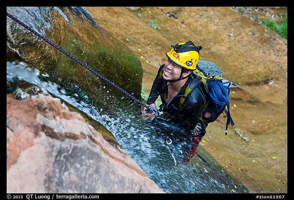 Canyoneer on rappel along waterfall. Zion National Park, Utah (color)
